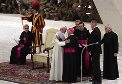 Pope Francis greets Andre Marceau bishop of Nice after he received family members of the victims of the Bastille Day terror attacks in Nice, France, renewing his condolences and promises of prayer for their healing and for the souls of their loved-ones. On 14 July 2016, a 19 tonne cargo truck was deliberately driven into crowds celebrating Bastille Day on the Promenade des Anglais in Nice, France, resulting in the death of 86 people and injuring 434. The pope denounced violence in the name of religion, at the Vatican on September 24, 2016. Photo by Eric Vandeville/ABACAPRESS.COM