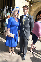 The brides mother MARCHIONESS OF READING and her son VISCOUNT ERLEIGHat the wedding of Lady Natasha Rufus Isaacs to Rupert Finch held at St.John The Baptist Church, Cirencester, Gloucestershire, UK on 8th June 2013.