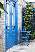 Blue door and Islamic tilework typical of Sidi Bou Said, Tunisia