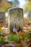 A headstone of the fallen Union soldier, from the Civil War Battle of Antietam1862 in Sharpsburg, Maryland is decorated with an American flag.