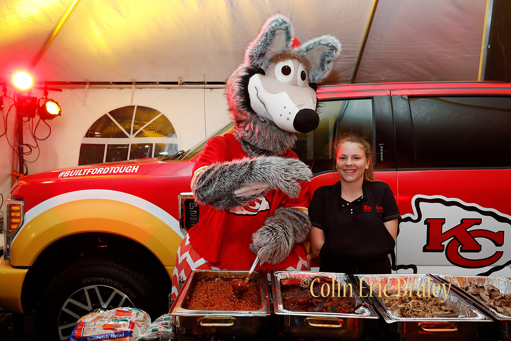 Kansas City Corporate Event and Marketing Photographer - KC Wolf serves Bar-B-Q from Zarda to fans at the Built Ford Tough Toughest Tailgate on Sunday, December 25, 2016, in Kansas City, MO. Photo by Colin E. Braley for Ford