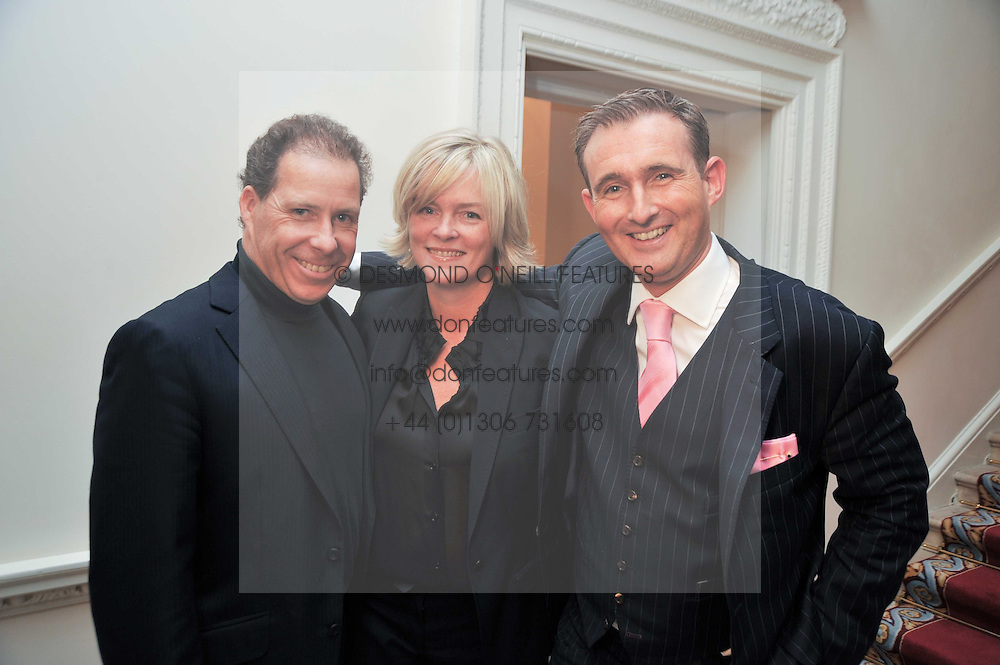 Left to right, VISCOUNT LINLEY, LADY BRUCE DUNDAS and TIM GOSLING at a party to celebrate the publication of Gosling - Classic Design for Contemporary Interiors by Tim Gosling held at William Kent House, The Ritz Hotel, London on 1st October 2009.