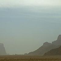 Haze from a sandstorm hangs over peaks of Wadi Rum, Jordan.