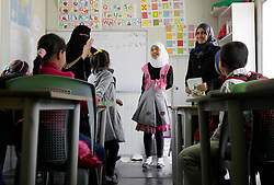 @ Licensed to London News Pictures 30/03/2015<br /> Azraq, Jordan -  Syrian refugee children attend catch-up classes in Azraq, a rural town in eastern Jordan, close to the Azraq UNHCR refugee camp. Local Jordanian charities set up the classes in portacabins, as the majority of Syrian children living outside the camp were unable to attend local schools due to lack of spaces.<br /> Photo: Anna Branthwaite/LNP