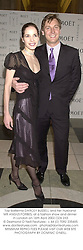 Top ballerina DARCEY BUSSELL and her husband MR ANGUS FORBES, at a fashion show and dinner in London on 16th April 2002.OZA 233