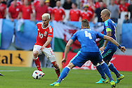 Aaron Ramsey of Wales (l) in action. Euro 2016, Wales v Slovakia at Matmut Atlantique , Nouveau Stade de Bordeaux  in Bordeaux, France on Saturday 11th June 2016, pic by  Andrew Orchard, Andrew Orchard sports photography.
