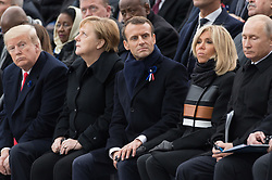 Macron touches this hand of his wife.<br /> Morocco's King Mohammed VI and his son, first lady Melania Trump, U.S. President Donald Trump, German Chancellor Angela Merkel, Emmanuel Macron and Brigitte Macron, Russian President Vladimir Putin and Australian Governor-General Peter Cosgrove.<br /> French President Emmanuel Macron and Brigitte Macron, German Chancellor Angela Merkel, U.S. President Donald Trump, first lady Melania Trump, Morocco's King Mohammed VI, Russian President Vladimir Putin, Australian Governor-General Peter Cosgrove attend a commemoration ceremony for Armistice Day, 100 years after the end of the First World War at the Arc de Triomphe.<br /> Paris,FRANCE-11/11/2018 Photo by Jacques Witt/pool/ABACAPRESS.COM