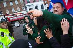 "Mayfair, London, November 28th 2014. A protest against Egypt's leader Al-Sisi descended into moinor scuffles as right wing ""patriots"" from anti-Islamic group Britain First arrived to protest against the presence of Islamist preacher Anjem Choudary, who was recently arrestred as part of an ant-terror operation. Playing patriotic British Music, Britain First accused Muslims of worshiping a ""devil"" and a ""paedophile prophet"". Police had to intervene before hotheads on both sides became violent. PICTURED: Britain First activists trade insults with Muslims"