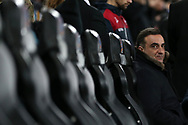 Carlos Carvalhal, the Swansea city manager looks on from his seat in the dugout. Premier league match, Swansea city v Liverpool at the Liberty Stadium in Swansea, South Wales on Monday 22nd January 2018. <br /> pic by  Andrew Orchard, Andrew Orchard sports photography.