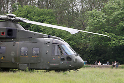 ©Licensed to London News Pictures. 07/06/2012.Stanwick, Northamptonshire. A Merlin helicopter from 78 Squadron made a controlled emergency landing in a field yesterday (06 June 2012) after neoprene tape used on rotors to protect the aircraft from operations in Afghanistan came unstuck during an exercise. No one was injured and the aircraft took off this morning.  Photo credit: Steven Prouse/ LNP.