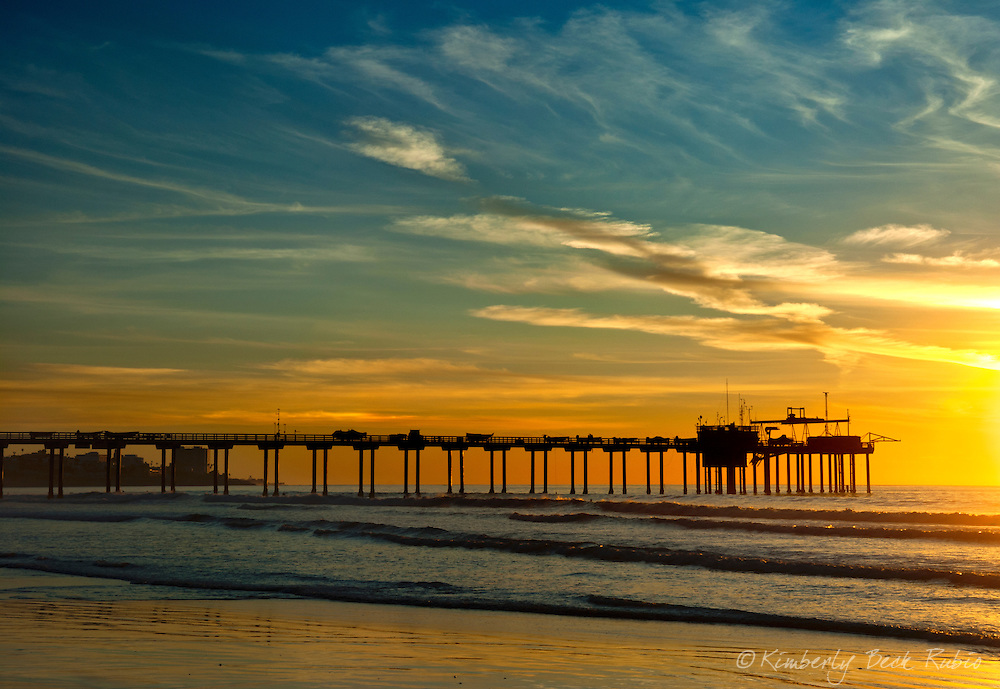 Sunset at La Jolla's Scripps Pier, part of Scripps Institute of Oceanography, with downtown La Jolla in the background beneath the pier.