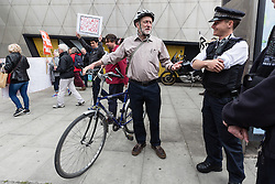 © Licensed to London News Pictures. 14/05/2016. LONDON, UK. JEREMY CORBYN with his bicycle, speaking to police officers at the start of a protest and march along Holloway Road, ending outside Holloway prison to protest against the housing bill and closure of Holloway prison. Protesters accuse the government of selling off the publicly owned inner city prison to private property developers, accelerating gentrification and worsening the UK's housing crisis. MP for Islington North, Jeremy Corbyn joined protesters and spoke of his support at the start of the demonstration.  Photo credit: Vickie Flores/LNP