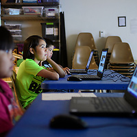 Seth Henio, 11, during a YouTube class taught by Markos Chavez, the technology trainer at the library, Wednesday July 11 at the children's branch of the Octavia Fellin Public Library.