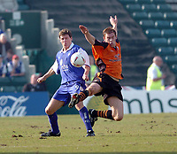 Photo. Leigh Quinnell.  Gillingham v Ipswich Town Coca Cola championship. 24/01/2005. Ipswich's Richard Naylor performs an acrobatic tackle on Gillinghams Darius Henderson.