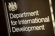 """Sign for DfID Department for International Development. London, UK. DFID is a United Kingdom government department. It was separated from the Foreign and Commonwealth Office in 1997. The goal of the department is """"to promote sustainable development and eliminate world poverty""""."""