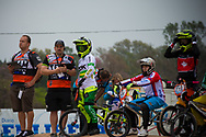 #68 (BUCHANAN Caroline) AUS talking to her coach at the 2014 UCI BMX Supercross World Cup in Santiago Del Estero, Argentina.