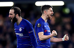 Chelsea's Jorginho (right) and Gonzalo Higuain celebrate after their team win the penalty shoot out at the end of the UEFA Europa League, Semi Final, Second Leg at Stamford Bridge, London.