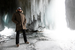 Dmitry Khitrov in an ice cave on an island in the middle of Lake Baikal after the Baikal Mile Ice Speed Festival. Maksimiha, Siberia, Russia. Sunday, March 1, 2020. Photography ©2020 Michael Lichter.