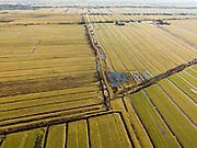 Nederland, Utrecht, Gemeente Oudewater, 20-02-2012; Polder Papekop (links) gescheiden van de Polder Ruige weide (rechts) door de Papekoper kade. Onder in beeld de Polder het Westeinde van Waarder, links de Oostkade, naar rechts de Ruigweidse achterkade. Op het kruispunt van de verschillende veenkades veenputten. De polders vinden hun oorspong in ontginningen van verschillende datum en/of door verschillende eigenaren,  vandaar de verschillende hoek van de verkavelingen. Kenmerkend voor de inrichting van de polders zijn de regelmatig gevormde ontginningsblokken, zogeheten cope-ontginningen. Cope of kop komt terug in de plaatsnamen..Polder Papekop (left) separated from the Polder Ruige Kade by means of a quay. At the crossroads of the various quays, holes left by the excavation of peat. The polders were cultivated at different dates (and or by different owners), hence the different angles of the allotments. Characteristic for the 'design' of the polder are the regularly shaped reclamation blocks, known as cope reclamations. .luchtfoto (toeslag), aerial photo (additional fee required);.copyright foto/photo Siebe Swart.