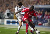 10/3/2004 Madrid, Spain.<br />Champions League,  8round, 2 Leg.<br />R.Madrid 1 - Bayern 0<br />R.Madrid's Raul in duel with Bayern's Kuffour at Santiago Bernabeu's Stadium.<br />© 2004 Alejandro leon Fernandez