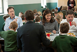 © Licensed to London News Pictures.  29/04/2015. Chippenham, Wiltshire, UK.  Deputy Prime Minister and leader of the Liberal Democrats Nick Clegg and his wife Miriam González Durántez visit a primary school in Chippenham to campaign alongside local candidate Duncan Hames (right).  They visited Ivy Lane Primary School to meet pupils and teachers. They helped to prepare and serve lunch at the school before talking to staff about how pupils are benefiting from the Pupil Premium and capital funding to support the provision of universal free school meals.  The Liberal Democrats have set out education funding as a red line and would not enter coalition with any party that does not agree to protect per pupil funding from nursery to 19, in real terms.  Photo credit : Simon Chapman/LNP