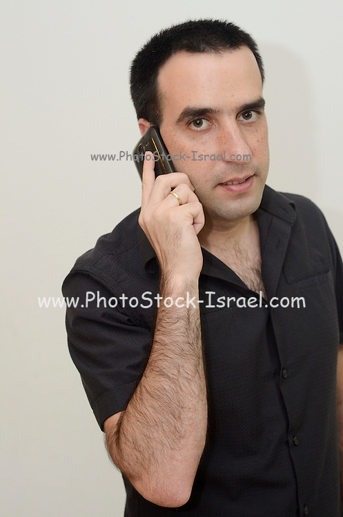 Young man in his thirties on his cell phone