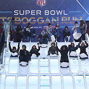 People young and old enjoy the Super Bowl Toboggan Run during Super Bowl week activities in Times Square, New York, USA. 29th January 2014. Photo Tim Clayton