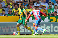 Steven Whittaker takes on Jason Puncheon during the Barclays Premier League match between Norwich City and Crystal Palace at Carrow Road, Norwich, England on 8 August 2015. Photo by Craig McAllister.