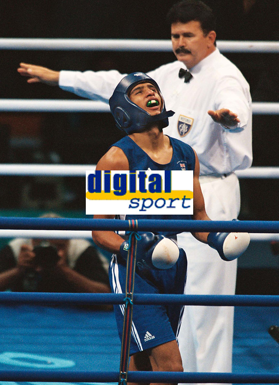 Amir Khan(GBR) Blue shows his delight at the end of the contest. Amir Khan v Serik Yeleuov (Kaz) Boxing Mens Light 60k Semi Final 28/8/2004.Athens Olympic games 2004. Credit : Colorsport/Andrew Cowie.