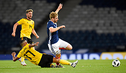 Belgium's Youri Tielemans (left) and Scotland's Stuart Armstrong battle for the ball during the International Friendly at Hampden Park, Glasgow.