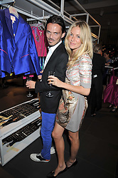 MATTHEW WILLIAMSON and SIENNA MILLER at a party to celebrate the launch of the Matthew Williamson collection at H&M held at the H&M store, Regent Street, London on 22nd April 2009.