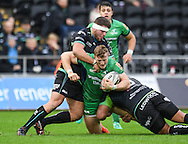 Connacht's Peter Robb is tackled by Ospreys' Nicky Smith and Ma'afu Fia.<br /> <br /> Guinness Pro12 rugby match, Ospreys v Connacht rugby at the Liberty Stadium in Swansea, South Wales on Saturday 7th January 2017.<br /> pic by Craig Thomas, Andrew Orchard sports photography.