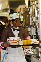 Waiters carrying breakfast orders, Cafe du Monde, French Quarter, New Orleans, Louisiana, USA