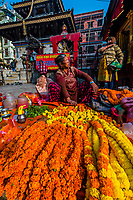 A street vendor selling Marigold garlands, significant in Hinduism, Durbar Square, Kathmandu, Nepal.