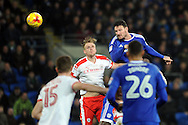 Cardiff City's Sean Morrison (r) beats Barnsley's Marc Roberts to a header. EFL Skybet championship match, Cardiff city v Barnsley at the Cardiff city stadium in Cardiff, South Wales on Saturday 17th December 2016.<br /> pic by Carl Robertson, Andrew Orchard sports photography.