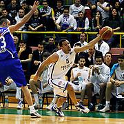 Anadolu Efes's Jordan Farmar (R) during their Turkish Basketball League match Anadolu Efes between Turk Telekom at the Ayhan Sahenk Erdem Arena in Istanbul, Turkey on Sunday, 09 March, 2013. Photo by Aykut AKICI/TURKPIX