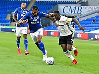 Football - 2019 / 2020 Championship - Play-off semi-final - 1st leg - Cardiff City vs Fulham<br /> <br /> Leandro Bacuna of Cardiff City & Neeskens Kebano of Fulham<br /> in a match played with no crowd due to Covid 19 coronavirus emergency regulations, in an almost empty ground, at the Cardiff City Stadium<br /> <br /> COLORSPORT/WINSTON BYNORTH