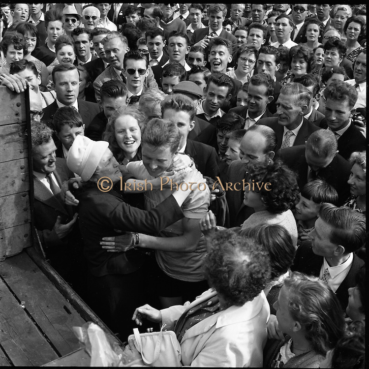 25/06/1961<br /> 06/25/1961<br /> 25 June 1961<br /> Rás Tailteann at Parnell Square, Dublin. Winner Tom Finn is congratulated by his mother at the finish line. <br /> The Rás Tailteann is an annual 8-day international cycling stage race held in Ireland.
