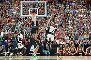 29 MAR 2015: Travis Trice (20) of Michigan State University strains to block a shot by Terry Rozier (0) of the University of Louisville during the 2015 NCAA Men's Basketball Tournament held at the Carrier Dome in Syracuse, NY. Michigan State defeated Louisville 76-70 to advance. Brett Wilhelm/NCAA Photos