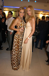 Left to right, JACQUI AINSLEY and ERICA WHITE at the launch of Roberto Cavalli Vodka held in the International Designer Room, Harrods, Hans Crescent, London on 5th December 2006.<br /><br />NON EXCLUSIVE - WORLD RIGHTS