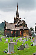 "Built in 1170, Lom Stave Church (stavkirke or stavkyrkje) was rebuilt into a cruciform, triple-nave church in 1663 and restored in 1933 and 1973. Visit this wooden Norman-style church in the town of Lom, in Gudbrandsdal traditional district, Oppland county, Norway. ""Staves"" are upright logs that support the central room framework."