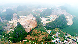 June 5, 2017 - Nanning, Nanning, China - Nanning, CHINA-June 5 2017: (EDITORIAL USE ONLY. CHINA OUT) ..A heavily-exploited karst hill is transformed into flat land in Nanning, southwest China's Guangxi. It's the 46th World Environment Day on June 5th, 2017. (Credit Image: © SIPA Asia via ZUMA Wire)