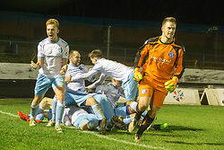 Forfar Athletic's Gavin Swankie (hidden) celebrates after scoring their fourth goal with team-mates. Cowdenbeath 3 v 4 Forfar Athletic, Scottish Football League Division Two game played 17/12/2016 at Central Park.