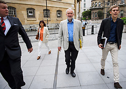 © Licensed to London News Pictures. 10/07/2016. London, UK. Labour Party Leader JEREMY CORBYN arrives at the BBC Broadcasting House in London with his wife LAURA ALVAREZ (left) and Director of Strategy SEUMAS MILNE (right), to appear on the Andrew Marr Show on July 10, 2016.  Photo credit: Ben Cawthra/LNP