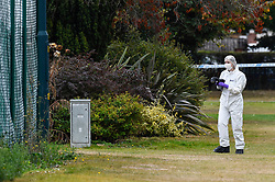© Licensed to London News Pictures. 22/09/2019. SLOUGH, UK.  A forensics officer at work at Salt Hill Park in Slough, Berkshire, where it is reported a 15 year old boy was fatally stabbed after an altercation with another male.  Emergency services attended the scene at 6.30pm on the evening of 21 September where the boy was pronounced dead.  Investigations are ongoing.  Photo credit: Stephen Chung/LNP