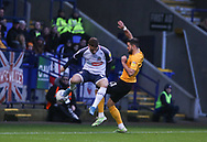 Bolton Wanderers Thibaud Verlinden(left) and Southend United midfielder Stephen McLaughlin in action during the EFL Sky Bet League 1 match between Bolton Wanderers and Southend United at the University of  Bolton Stadium, Bolton, England on 21 December 2019.
