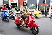 A man carries his Basset Hound on his Vespa moped in Monastiraki. Athens is the capital and largest city of Greece. It dominates the Attica periphery and is one of the world's oldest cities, as its recorded history spans around 3,400 years. Classical Athens was a powerful city-state. A centre for the arts, learning and philosophy.