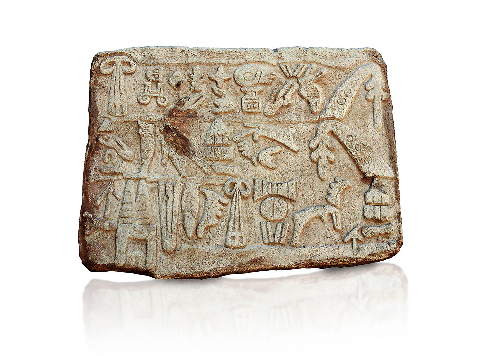 Hittite Hieroglyphic panel from a cult chamber 2 built by Suppiiuliuma II in Hattusa, Hittite New Kingdom 1207–1178 BC, Bogazkale archaeological Museum, Turkey. White background<br /> <br /> The Luwian hieroglyphics is a kind of hieratic script which was developed in Anatolia and has no relationship to Egyptian hieroglyphics. In these panels King Suppiluliuma II mentions that by the support of many gods he has conquered many countries including the Land of Tarhuntassa, where he has built new cities and has offered sacrifices to the gods. The chamber may have been a symbolic entrance to the underworld which plays an important part in Hittite cult and beliefs