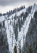 Skiers and riders fill the Pioneer quad and Garfield double chairlifts on a busy January Saturday at Monarch Mountain.