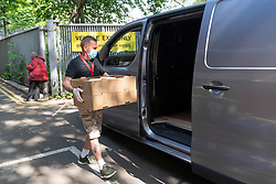 © Licensed to London News Pictures. 24/04/2020. London, UK.  A delivery driver collects food from Refettorio Felix at St Cuthbert's Centre in Earls Court for distribution to an NHS hospital. The organisation now provides more than 500 meals a day seeing a ten-fold increase since the Covid 19 outbreak.It also provides meals to refugees, children of NHS staff and to the venerable with mental health issues. Editorial usage only. Photo credit: Ray Tang/LNP